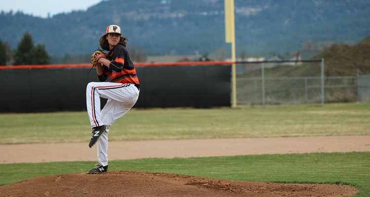 Jake Phennings pitches at home for the Trojans. Photos by the PFHS Odyssey Yearbook staff.