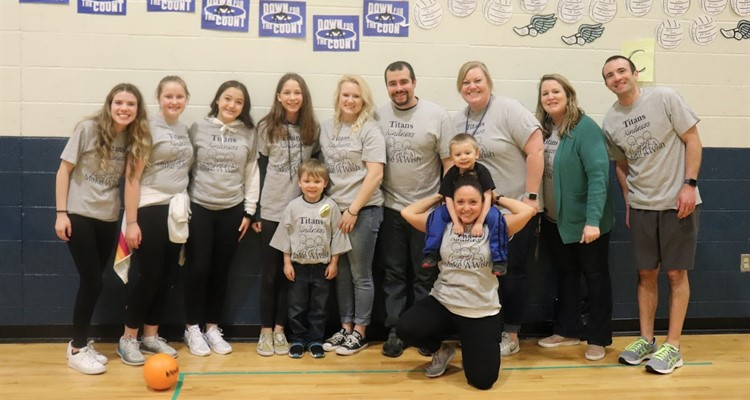 RCMS students and staff pictured with Make-A-Wish recipient and his family at Dinner & Dodgeball Fundraiser.  RCMS raised $5,184 to be donated to Make-A-Wish.