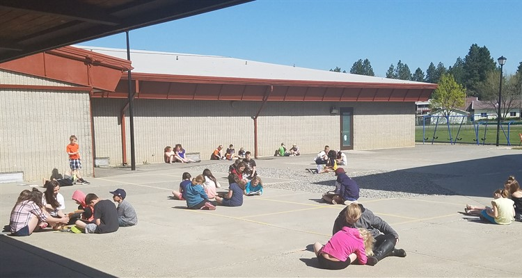 Enjoying the sun with our Reading Buddies!